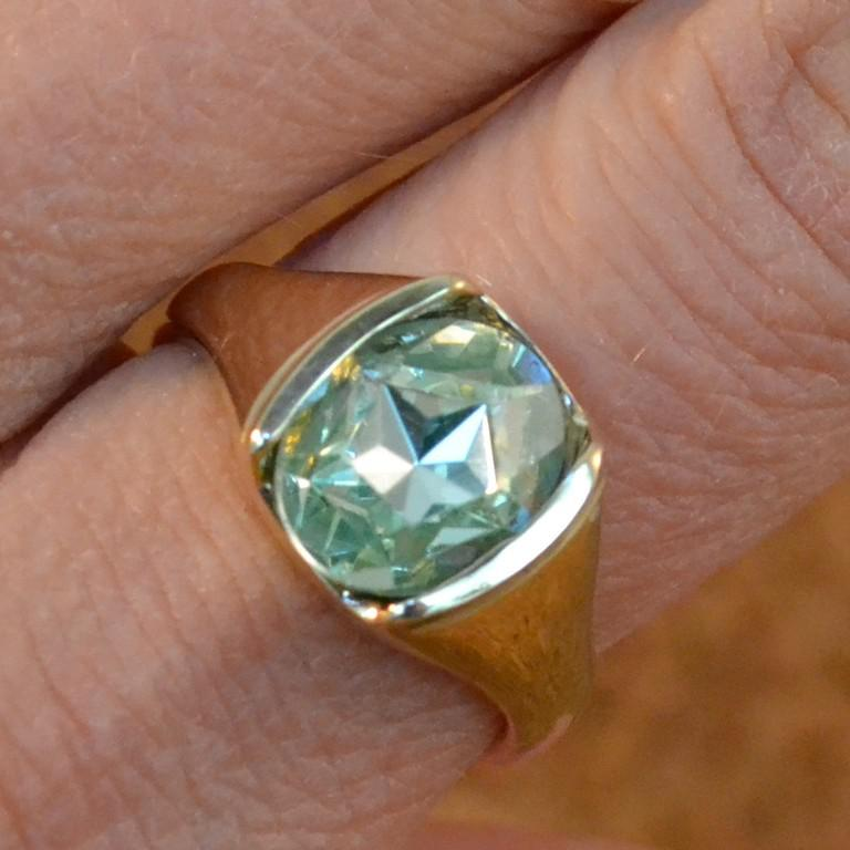 14k yellow gold and green stone