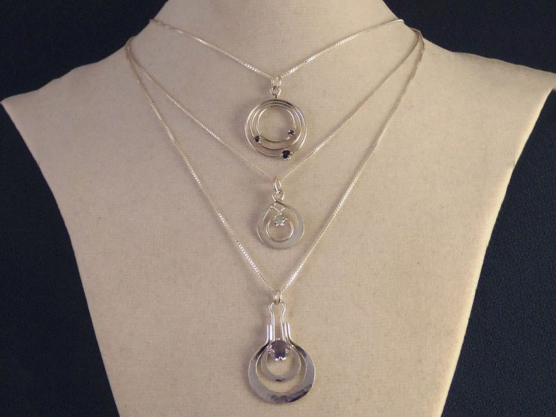 Sapphire Orbits Pendant, Blue Topaz Double Tear Drop Pendant, and Iolite Hammered Pendant